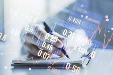 Multi exposure of abstract creative financial graph with hand writing in notepad on background, forex and investment concept