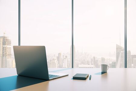 Laptop with a cup of coffee on the desktop against the background of a window with a city view. 3D Rendering Stock fotó