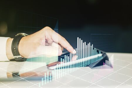 Abstract creative financial graph with finger clicks on a digital tablet on background, forex and investment concept. Multiexposure Фото со стока