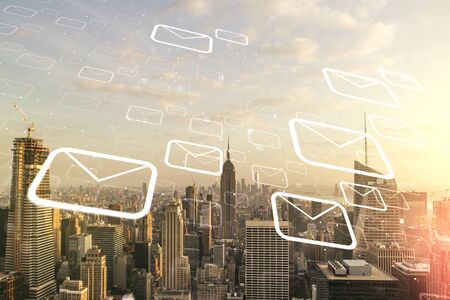 Double exposure of abstract virtual postal envelopes hologram on New York city skyscrapers background. Electronic mail and spam concept Stock Photo