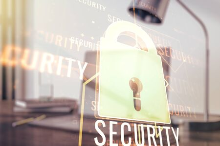 Double exposure of creative lock hologram with chip on laptop background. Information security concept