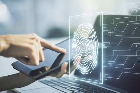 Double exposure of abstract creative fingerprint hologram with finger clicks on a digital tablet on background, protection of personal information concept