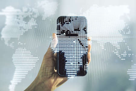 Double exposure of abstract digital world map and hand with cellphone on background, big data and blockchain concept