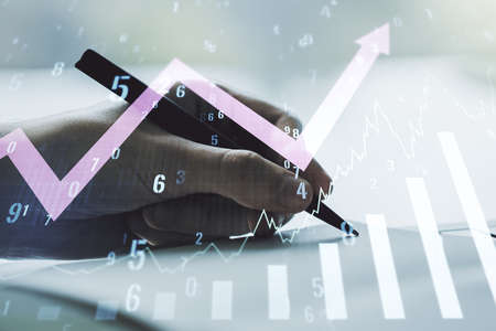 Abstract creative financial graph with upward arrow and man hand writing in notebook on background, forex and investment concept. Multiexposure