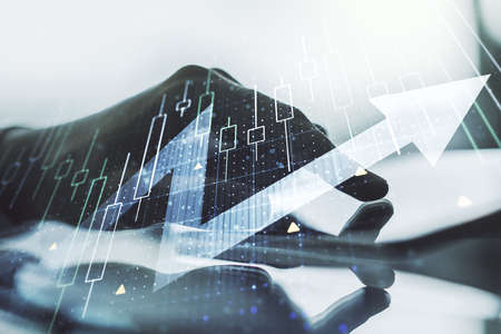 Double exposure of abstract creative financial diagram with upward arrow and finger clicks on a digital tablet on background, growth and development concept