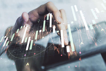 Multi exposure of abstract creative financial graph with finger presses on a digital tablet on background, forex and investment concept