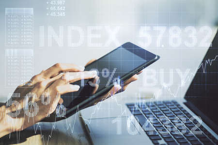 Multi exposure of abstract financial diagram and hand working with a digital tablet on background, banking and accounting concept Archivio Fotografico