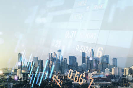 Abstract virtual financial graph hologram on Los Angeles cityscape background, financial and trading concept. Multiexposure