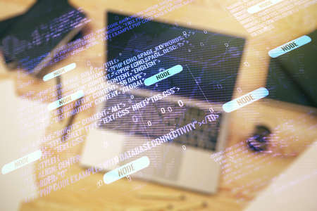 Multi exposure of abstract software development hologram with world map on laptop background, global research and analytics concept
