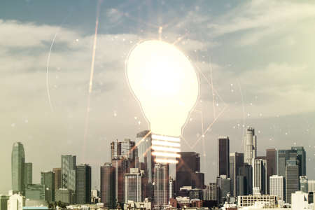 Virtual Idea concept with light bulb illustration on Los Angeles skyline background. Multiexposure