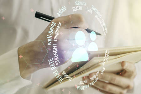 Double exposure of people icons hologram and man hand writing in notebook on background. Online insurance service concept Stockfoto