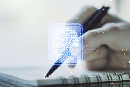 Double exposure of abstract creative fingerprint hologram with woman hand writing in notepad on background, protection of personal information concept