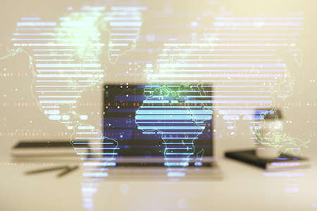 Multi exposure of abstract creative digital world map on laptop background, research and analytics concept