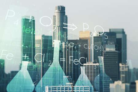 Abstract virtual creative chemistry hologram on Los Angeles skyline background. Multiexposure