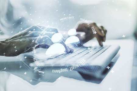 Creative abstract people icons hologram and hands typing on computer keyboard on background, life and health insurance concept. Multi exposure 免版税图像