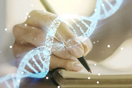 Creative light DNA illustration and woman hand writing in diary on background, science and biology concept. Multiexposure