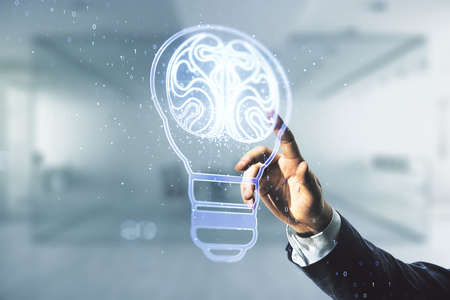 Man hand clicks on abstract virtual creative light bulb with human brain hologram on blurred office background, artificial Intelligence and neural networks concept. Multiexposure