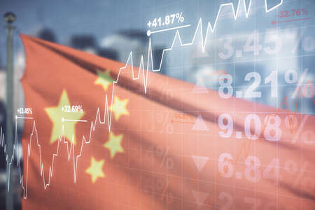 Double exposure of abstract creative financial chart hologram on flag of China and blurry skyscrapers background, research and strategy concept