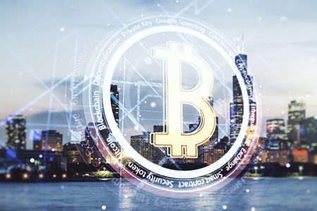 Double exposure of creative Bitcoin symbol hologram on Chicago office buildings background. Mining and blockchain concept