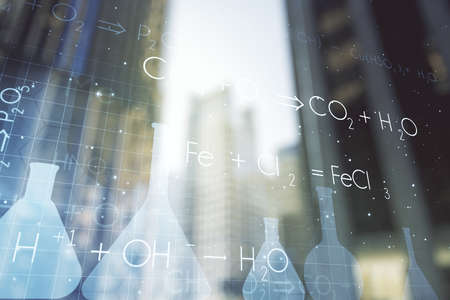 Double exposure of abstract virtual chemistry hologram on modern skyscrapers background, research and development concept Banque d'images