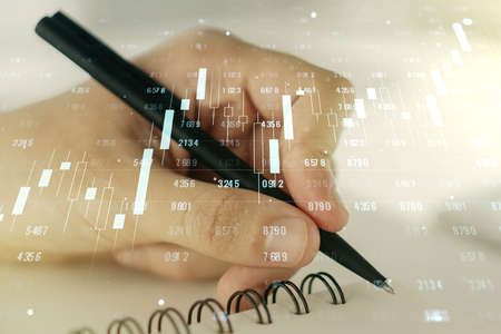 Abstract creative analytics data spreadsheet with man hand writing in diary on background, analytics and analysis concept. Multiexposure Imagens