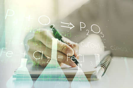 Creative chemistry illustration with man hand writing in diary on background, science and research concept. Multiexposure