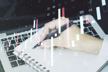 Abstract creative financial graph with hand writing in diary on background, financial and trading concept. Multiexposure Stock Photo