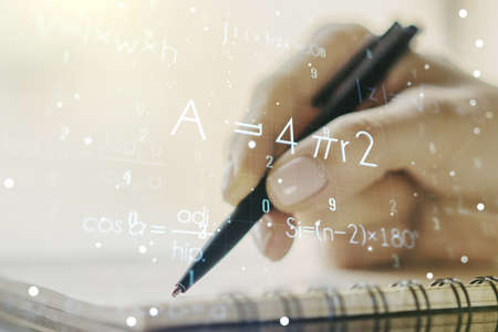 Creative scientific formula hologram with woman hand writing in notepad on background, research concept. Multiexposure Stock Photo