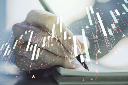 Multi exposure of abstract creative financial graph with hand writing in notepad on background, forex and investment concept Stock Photo