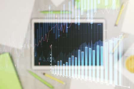 Multi exposure of abstract creative financial graph and modern digital tablet on background, top view, forex and investment concept