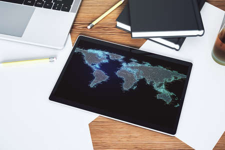 Modern digital tablet display with abstract creative world map, research and analytics concept. Top view. 3D Rendering
