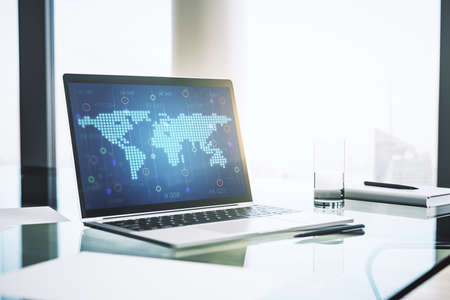 Abstract creative world map on modern laptop screen, international trading concept. 3D Rendering Stock Photo
