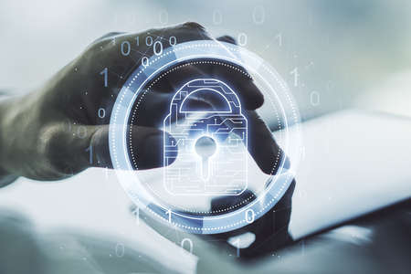 Creative lock sketch with chip hologram and hand working with a digital tablet on background, protection of personal data concept. Multiexposure Stockfoto