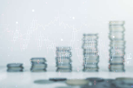 Abstract virtual financial graph hologram on stacks of coins background, forex and investment concept. Multiexposure 免版税图像