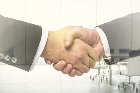 Double exposure of handshake two businessmen on meeting room interior background, research and strategy concept