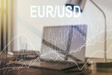 Double exposure of creative EURO USD forex chart hologram on laptop background. Banking and investing concept 스톡 콘텐츠
