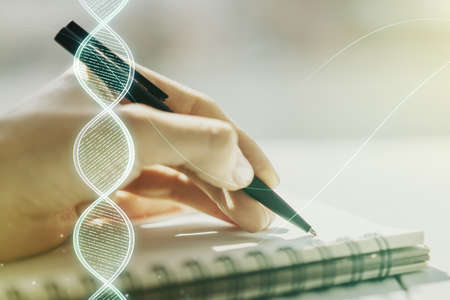 Creative concept with DNA symbol illustration and woman hand writing in notebook on background. Genome research concept. Multiexposure Imagens