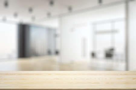 Empty tabletop made of wooden dies with light furnished office on background, template