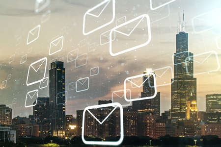 Double exposure of abstract virtual postal envelopes hologram on Chicago city skyscrapers background. Electronic mail and spam concept 版權商用圖片
