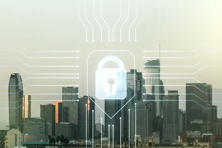 Double exposure of virtual creative lock hologram with chip on Los Angeles city skyscrapers background. Information security concept