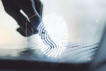Multi exposure of creative fingerprint hologram with hands typing on computer keyboard on background, personal biometric data concept Stockfoto