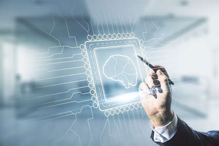 Man hand with pen working with virtual creative artificial Intelligence hologram with human brain sketch on blurred office background. Double exposure