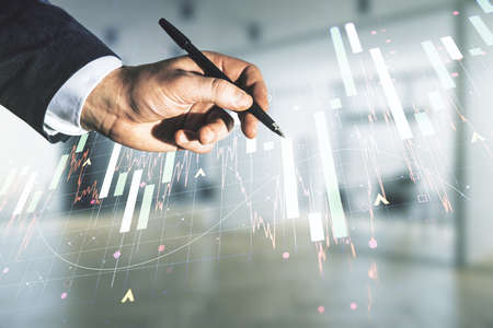 Man hand with pen working with abstract virtual financial graph on blurred office background, financial and trading concept. Multiexposure