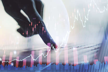 Multi exposure of abstract creative financial graph with world map and hand typing on laptop on background, forex and investment concept