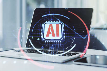 Double exposure of creative artificial Intelligence abbreviation with computer on background. Future technology and AI concept