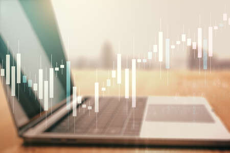 Double exposure of abstract creative financial chart on modern laptop background, research and strategy concept