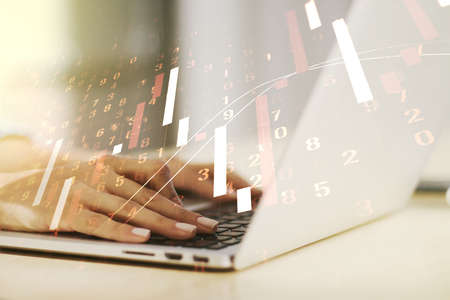 Abstract creative financial graph with hand typing on laptop on background, financial and trading concept. Multiexposure Stock fotó