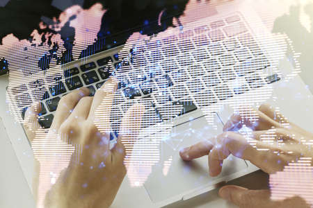 Double exposure of abstract digital world map and hand typing on laptop on background, big data and blockchain concept Reklamní fotografie
