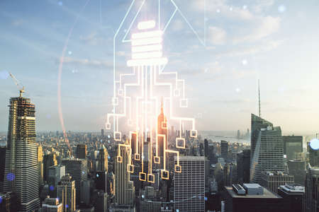 Double exposure of virtual creative light bulb hologram with chip on New York city skyscrapers background, idea and brainstorming concept Reklamní fotografie