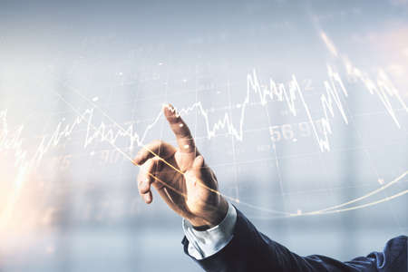 Multi exposure of man hand with pen working with abstract virtual financial graph on blurred office background, forex and investment concept